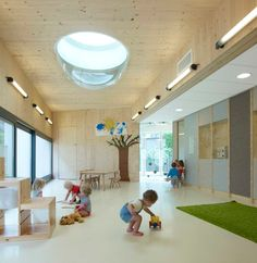 NEXT architects create stimulating daycare that mimics a city, in amsterdam. Toddlers roam among rooms varying in different heights to encourage activity