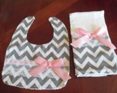 """This beautiful set of 3 bib is made with special touches for a unique handcrafted look. Its double sided with a soft towel in the reverse with a practical snap button, super absorbent . This set is a definite """"must-have"""" for all babies, great gift idea, quite the fancy addition to any outfit.  Machine Washable, 100% Cotton"""