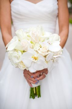 White and cream colored wedding bouquet with phalaenopsis orchids, mini calla lilies, cream de la cream roses and white hydrangeas by Robyn.
