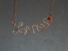 Handcrafted Valentine's Day Necklace - Love and Heart. $11.00, via Etsy.