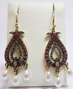 9ct Yellow Gold Ruby and Diamond Hook Wire Earrings with Three Cultured Freshwater Pearl Drops £495.00 Vintage Antique Reproduction Jewellery Contact us at www.facebook.com/ellisondaviesjewellery for more information