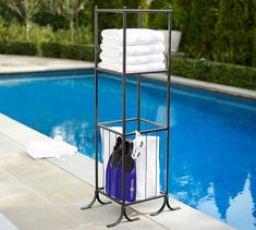 Browse pool storage and pool accessories at Pottery Barn. You'll find everything from floats and noodles to baskets and outdoor shelving in the wide selection. Pool Towel Storage, Towel Rack Pool, Towel Racks, Gym Towel, Winter Pool Covers, Diy Pool, Pool Fun, Pool Water Slide, Water Slides