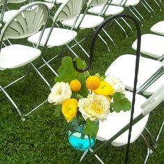 Hanging shepherds hook arrangements to line aisle (wedding aisle decor) for Cobblestone Farms Barn Ann Arbor Michigan wedding.  Features david austin patience roses, craspedia, yellow ranunculus, and geranium foliage