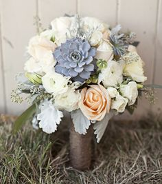 Peach flowers and slate blue succulents. LOVE!   Flower Factory in Vancouver