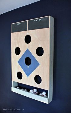 A DIY tutorial to make a baseball themed beanbag toss game. This beanbag toss has it's own beanbag holder and mounts flush to the wall. Woodworking Projects Diy, Diy Wood Projects, Projects For Kids, Diy Yard Games, Backyard Games, Outdoor Games, Diy Cornhole Boards, Bar Games, Dice Games