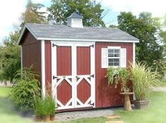 Amish Wood Classic Workshop Shed Kit Easy DIY shed kit with custom options. Available in numerous sizes to store equipment. Pre-cut for easy assembly. Customize with flower boxes and cupola if you wish. #sheds #DIYshed