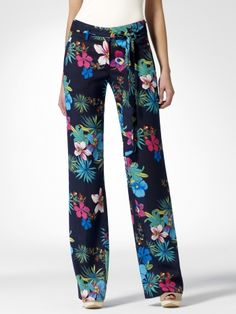 Tropical floral print palazzo pant with navy background. Side off seam pockets. Self belt. Zipper fly with bar closure.33 1/2 inch inseambrulli100% polyester/liliImport/liliDry clean br/li/ul