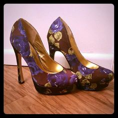Purple Floral Heels Was $18 #purplebrown #heels #shoes #goingout #platforms #brown #floralprint heels! Size 6.5 in great condition, only worn a couple time.  Some additional info: FREE gift with purchase! Bundle and SAVE at least 15% plus get combined shipping! All items from a clean and smoke free home! Thanks for looking! Liliana Shoes Heels