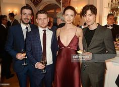 Money Monster mates Jack O'Connell (center L) & Caitriona Balfe (center R) @ 8th Annual Filmmakers Dinner hosted by Charles Finch & Jaeger Le-Coultre at Hotel du Cap-Eden Roc on May 13, 2016 in London, England.