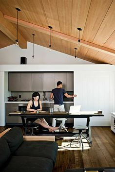 This compact house in Manhattan Beach, California makes its 30-by-30 foot footprint work with smart storage solutions like a kitchen easily hidden by sliding walls.