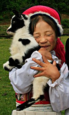 """Girl with Goat - Yunnan, China"" What a sweet love for nature. Or dinner. Whichever comes first ;)"