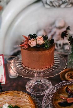Brides.com: . A single-tiered chocolate wedding cake topped with fresh flowers, created by Macrina Bakery.