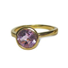 For some gorgeous Bling, a faceted 8 mm wide round purple amethyst, set in a lovely solid gold band .Handmade in London, the ring is solid 18ct yellow gold.Wear it alone or combined with other rings from the same collection, as shown on our model....