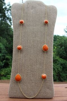Peach Roots - Gold Chain with Orange Teardrops, $25.00 (http://peachroots.com/gold-chain-with-orange-teardrops/)