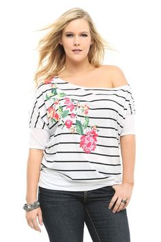 Wrapped in black stripes and blooming with a colorful flower print, this white tee is a chic addition to a fashion-forward wardrobe. Our Callie design has an off-shoulder silhouette and a banded bottom.