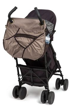 Georgi Diaper Bag by BabyCargo. Perfect mix of style and function. Did you ever wonder how to hang a diaper bag on an umbrella stroller? This ingenious bag has 2 loops at the top to accommodate all umbrella strollers. It'll stay put and look great in the process :)  and it has tons of pockets