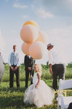 get the flower girls to carry big ballons down the isle rather than flowers