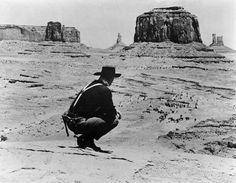 THE SEARCHERS - Ethan Edwards (John Wayne) looks down on the illusive Chief Scar's camp - Directed by John Ford - Warner Bros. Robert Duvall, Western Film, Western Movies, Marlon Brando, Catherine Deneuve, Ward Thomas, Ken Curtis, Warner Bros Movies, Westerns