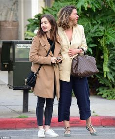 Casual chic: Lily Collins proved she could dazzle in more relaxed looks as well on Tuesday, as she enjoyed a casual dinner with a gal pal in LA