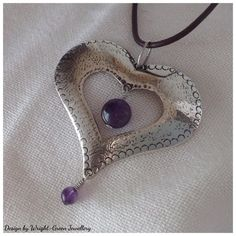 silver and amethyst heart pendant
