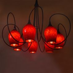 Piccolo Chandelier (7 light)  #multilightchandelier #artglasslighting #foyerlighting #blownglasslighting