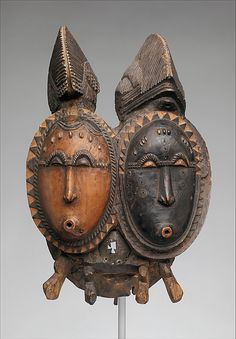 Mbolo Twin Mask (Nda) from the Baule people of the Bandama River region of the Ivory Coast | Wood, metal, patina stain | 19th to 20th century