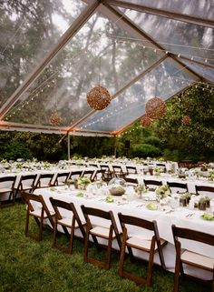 Clear tent with natural round chandeliers