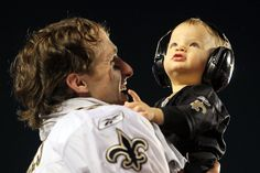 Drew Brees with his baby boy after winning the superbowl :)