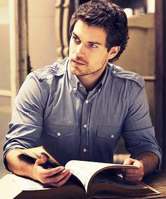 Henry Cavill as Lucas Conrad. He looks like he's doing some research, figuring out what's going on with Liz.