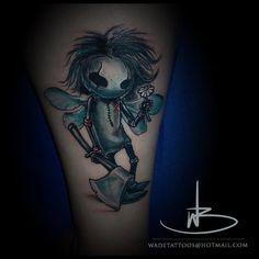 creepy creature tattoo