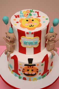 fisher price circus themed cake with a lion, tiger and 2 monkeys! http://www.facebook.com/sweetcravingstoronto