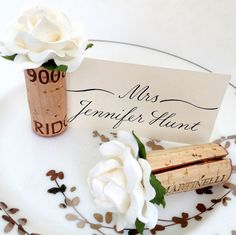 Wedding Place Card Holder Ideas - beautiful handmade Tiffany blooms on vintage wine corks. These make for a stunning Place Card Table!
