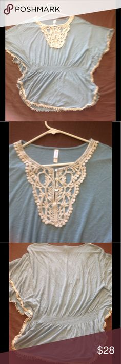 ‼️Beautiful Boho Chic Blouse Not Free People but is a Beautiful Boho Chic Blouse The color is more like a turquoise color I don't believe the picture got the color correctly it is a beautiful blouse and great for the summer it is a target brand but same style as free people. You will love it.  have so much to list due to domestic violence and now being homeless. I have been given so much time for Storage before I lose everythingSPREAD THE WORD THANK YOU VERYmuch Free People Tops Blouses