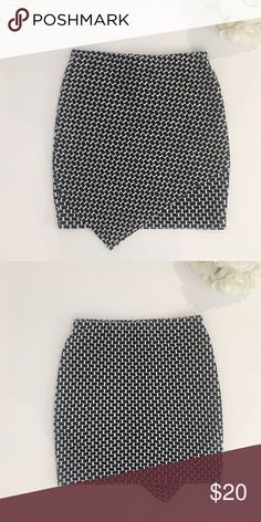 """H&M Asymmetrical Skirt H&M asymmetrical cut skirt. Pattern is navy and  ivory. Perfect for work with heels or running errands with tennis shoes. Waist: 13 1/4"""" Length: 17"""" H&M Skirts Asymmetrical"""