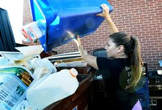 Waitress Jessica Helt dumps recycling in the bins outside the Buff Restaurant on Wednesday November 25, 2014. For more photos go to www.dailycamera.com Photo by Paul Aiken / The Boulder Daily Camera