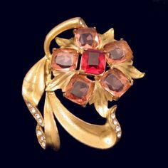 OH, SO RETRO! I love vintage retro brooches from the late 1940s and early 1950s. This one is striking in gold plated pot metal with beautiful red glass stones. $99. See more great vintage brooches and pins in my eBay store: http://stores.ebay.com/My-Classic-Jewelry-Shop/Brooches-Pins-Clips-/_i.html?_fsub=1589281016&_sid=102404336&_trksid=p4634.c0.m322