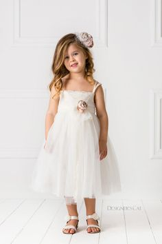A romantic ballet-style dress designed by #AlexandraPlati, made of excellent French #lace in the bust and cotton kippur lace in the straps and belt. It is decorated with #handmade flowers in shades of blush pink. A perfect choice for your little princess to look stunning at her special occasion. #PARIS dress comes with a matching bandana. #kidsfashion #luxuryDresses #designersCat #collection #communie