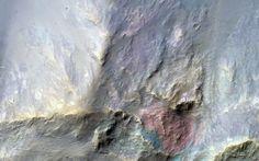 Red Bedrock in an Impact Crater Northeast of Hellas Planitia