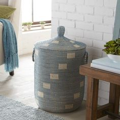 Woven of seagrass, our hamper is fitted with a lid and has easy-to-grab handles on both ends. Tastefully designed with a modified checkerboard design, it's almost too handsome to hide in a closet. Of course, just because we call it a hamper doesn't mean you have to use it for laundry. Use it to store blankets, seasonal clothes or other things. Its usefulness ends when you run out of ideas—and that never happens, right?