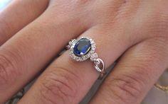Oval shape sapphire & round diamonds set on 14K white gold ring. $599.00, via Etsy.