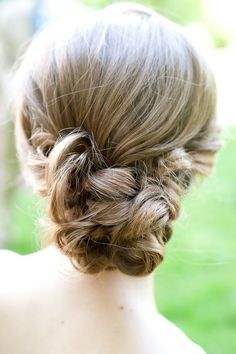 Twist the sides how you want it, put it in a low pony tail, take a small section of hair from the pony tail and wrap it around the pony tail holder, and then just take small strands of hair and roll it how you want. (Then Hairspray) Have braids coming back to it