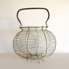 A personal favorite from my Etsy shop https://www.etsy.com/listing/224786359/large-french-vintage-wire-egg-basket