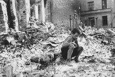 9-year old Polish boy in the ruins of Warsaw, September 1939.