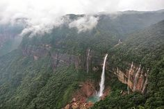 Nohkalikai Falls is the tallest plunge waterfall in India with a height of 340 metres. This #beautiful falls sits on the edge of the #Cherrapunji Plateau and is always fed by the rain. Below the #falls there has formed a #plunge pool with unusual #green colored water.  The falls derives it name from an interesting #legend.  According to legends in a village called Rangjyrteh upstream from #Nohkalikai Falls a woman named Likai resided but had to remarry after her husband died. Ka Likai (Ka is…