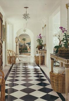 Cool tropical hallway ~ I love the light fixtures and mural at the end of the hall.