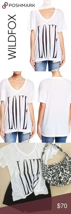 "✨ Wildfox Big Love Oversized Graphic V-Neck A super comfy, oversized graphic tee. Short-sleeve, v-neck, and perfect for casual days. This is a size XS, but could easily fit anyone up to a L.  Vince Camuto shorts pictured are available separately for purchase.  Approximately 26.5"" long. Approximately 20"" across the bust, laid flat.  50% cotton 50% polyester  ❌ Sorry, no trades.   vneck  210249 Wildfox Tops Tees - Short Sleeve"