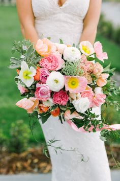 Yellow, pink and white bouquet with ranunculus, poppy and peony.