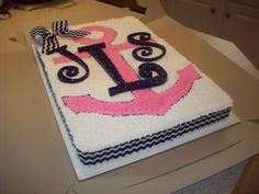 anchor cake with initials but use teal color instead of pink (for maylen at least..lol)