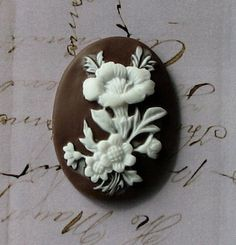 10 pcs  Brown Resin Flower Oval Cameo Cabochons by SandraSupplies, $3.75