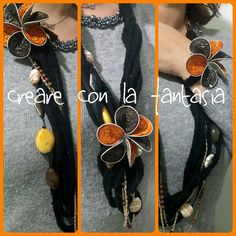 Collane in lana... con catene e perle e fiore staccabile con le cialde del caffè da applicare dove si preferisce nella collana o come bracciale